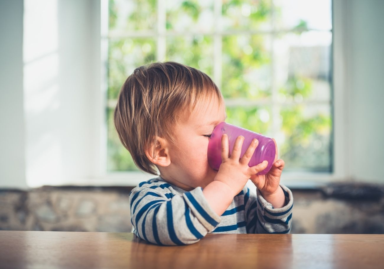 baby drinking open cup