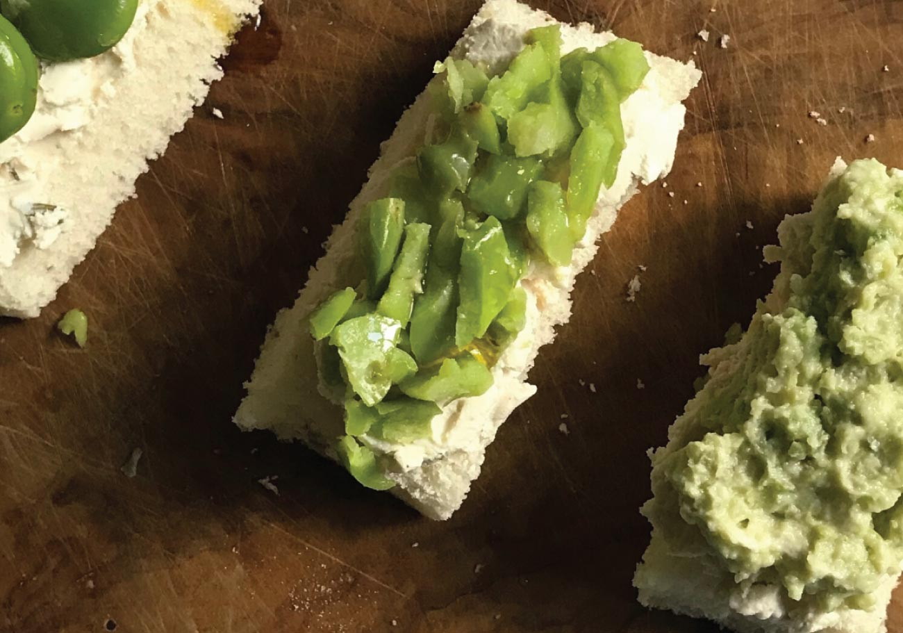 Broad beans and cream cheese on toast